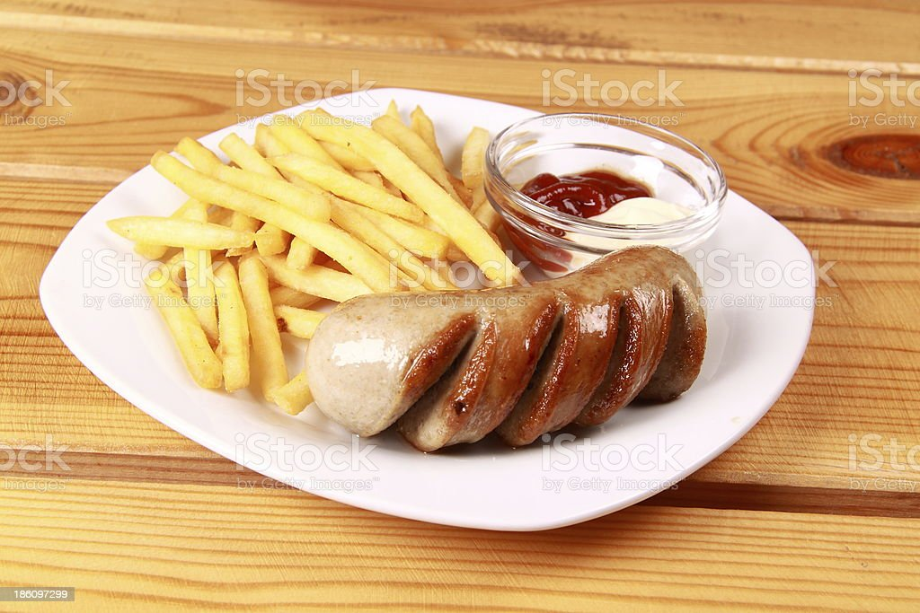 grilled sausages with French fries and ketchup royalty-free stock photo