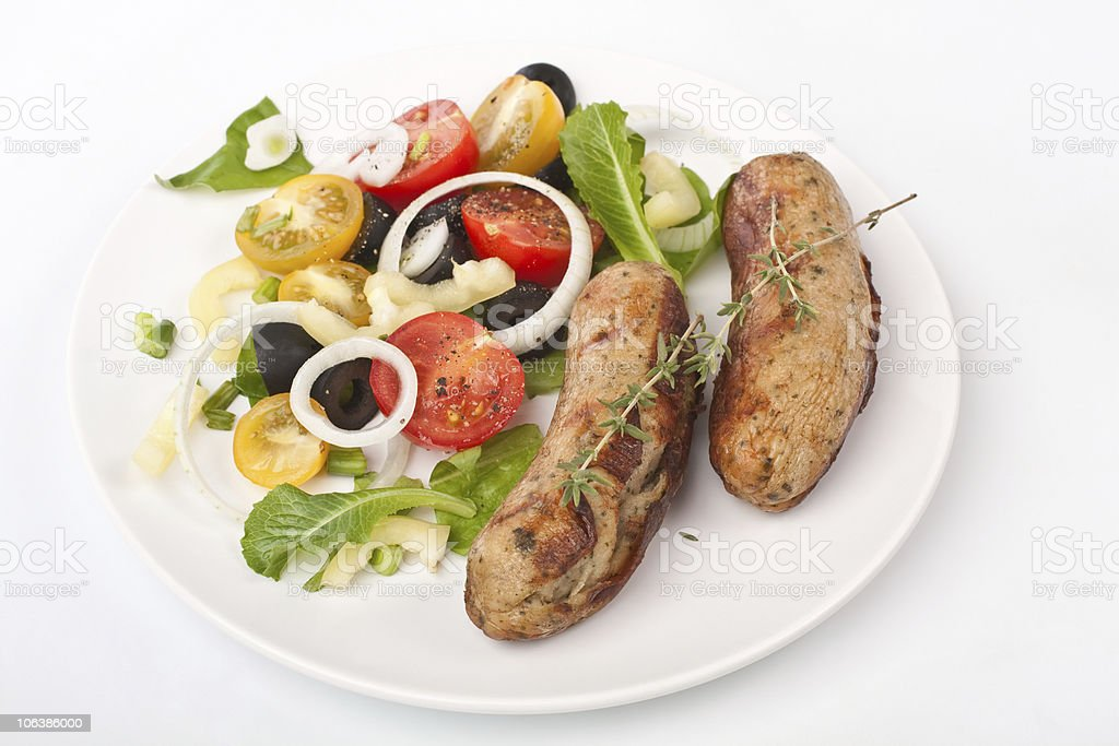 grilled sausages with vegetable salad royalty-free stock photo