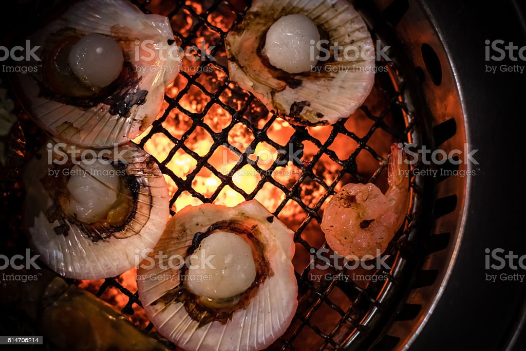 Grilled Scallop Seafood Cooking on Flaming Grill stock photo