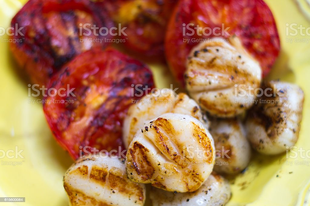 Grilled Scallops and Tomatoes (Close-Up) stock photo