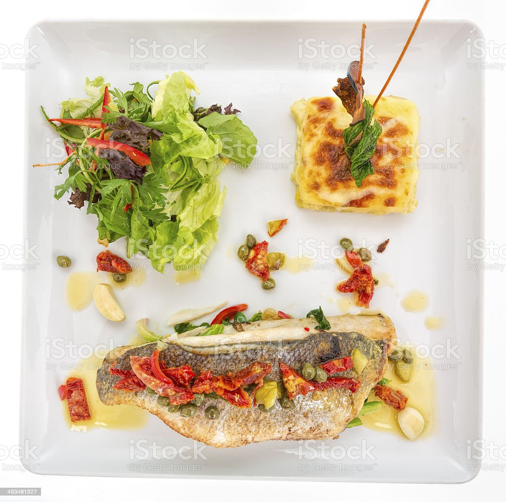 Grilled sea bass with potato pancake and salad royalty-free stock photo