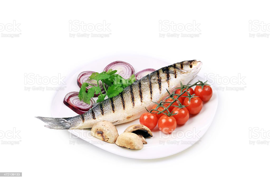 Grilled seabass on plate with tomatoes. stock photo