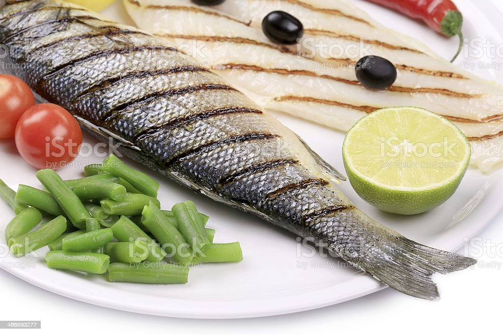 Grilled seabass with pangasius fillet. royalty-free stock photo