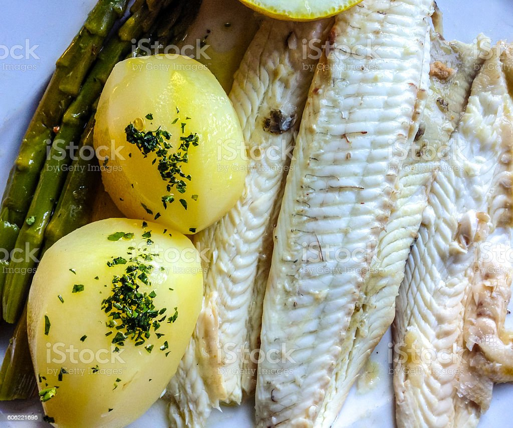 Grilled seabass with potato and asparagus stock photo
