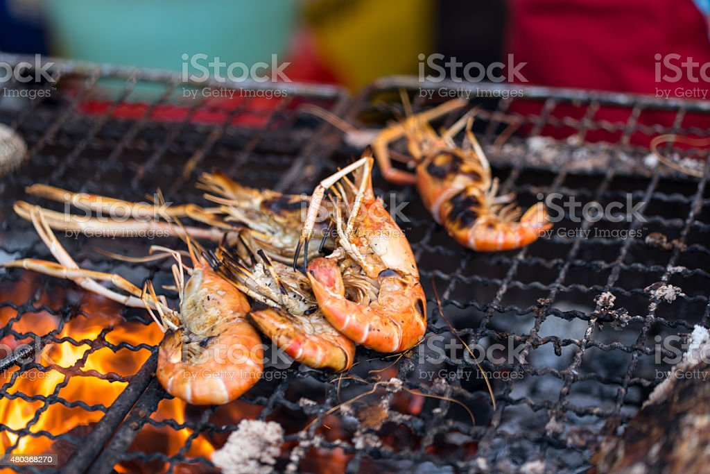 Grilled shimps on street food stock photo