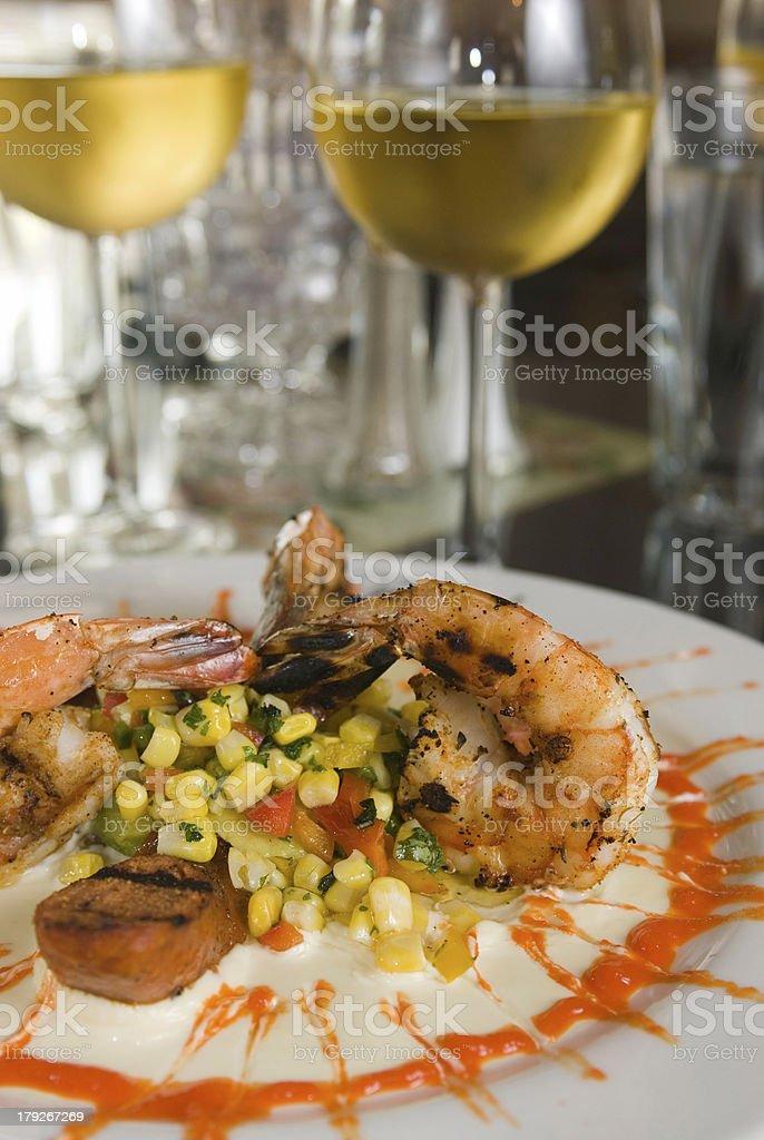 Grilled shrimp corn salsa cream sauce white wine royalty-free stock photo