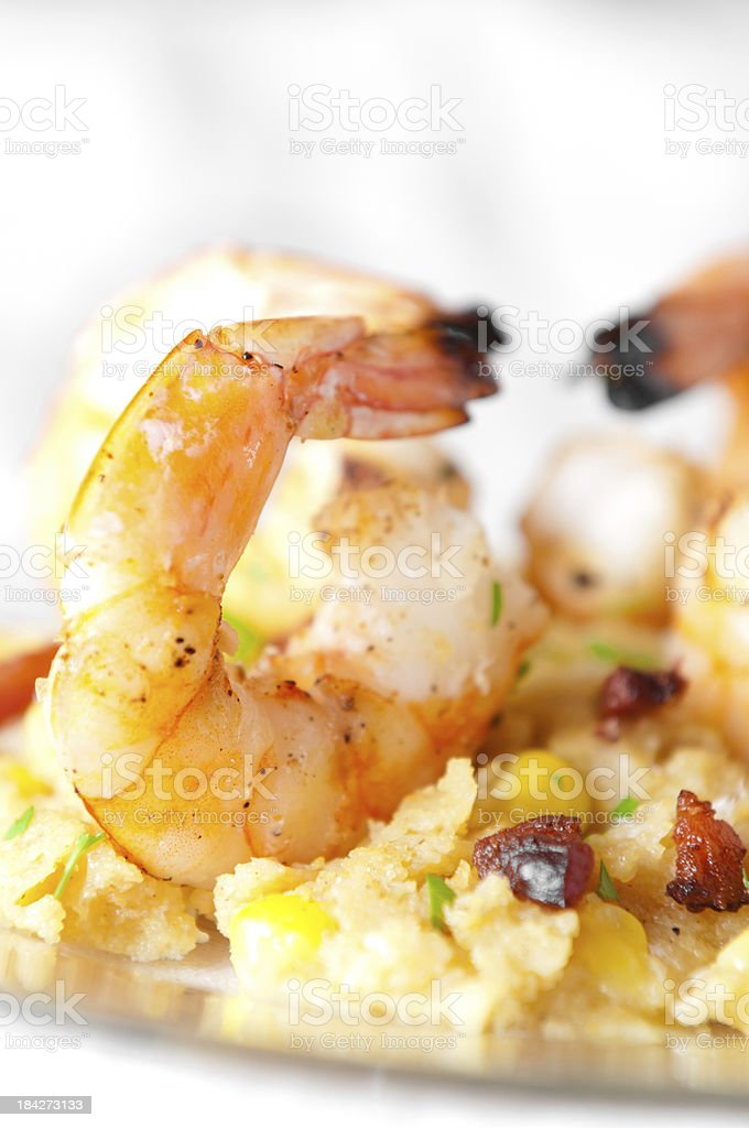 Grilled Shrimp on Parmesan Polenta with Fresh Corn and Bacon stock photo