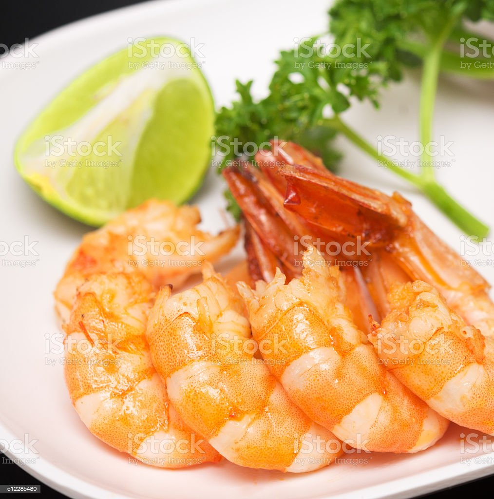 grilled shrimp on plate stock photo