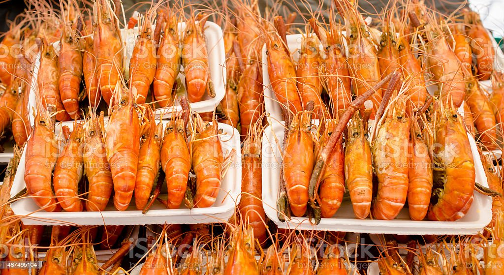 Grilled shrimp sale on street market stock photo