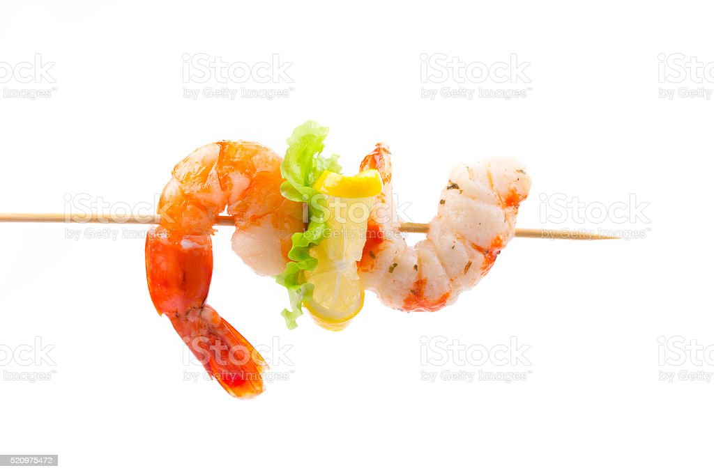 Grilled shrimps on a stick. stock photo