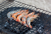 Grilled shrimps on grill.