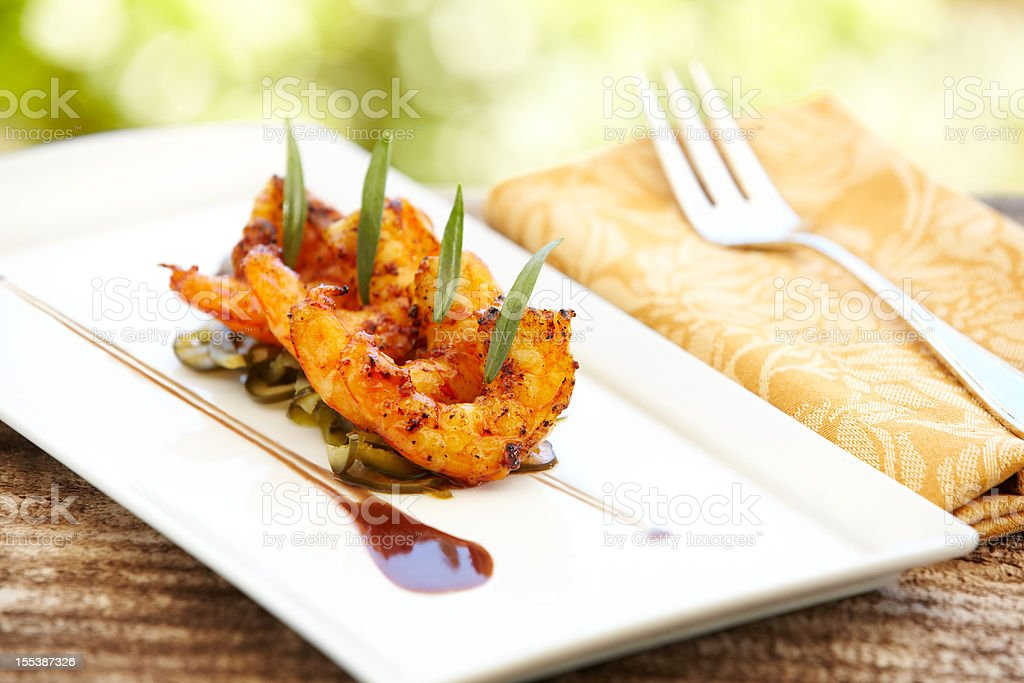 Grilled shrimps on plate at a restaurant outdoors royalty-free stock photo