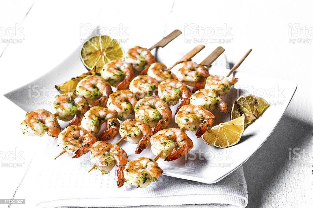 Grilled shrimps with limes stock photo