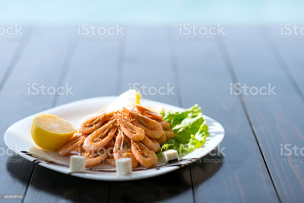 Grilled Shrimps with Spices and Lemon by the Sea stock photo