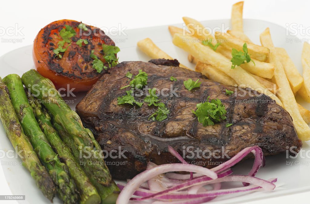 Grilled sirloin steak and fries dinner royalty-free stock photo