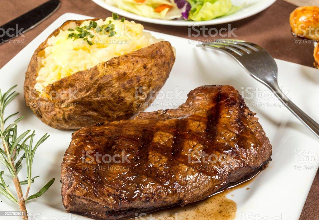 grilled sirloin steak dinner stock photo