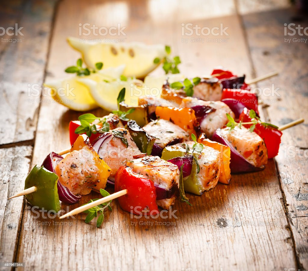 Grilled skewers of salmon and vegetables stock photo