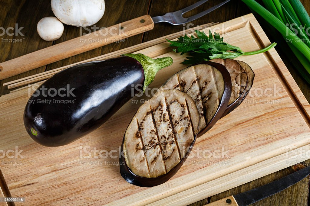 Grilled slices of Eggplant on cutting board stock photo