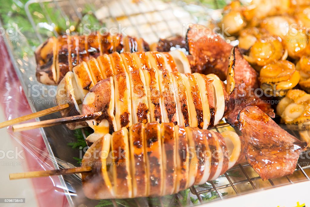 Grilled Squid on Bamboo Skewers stock photo