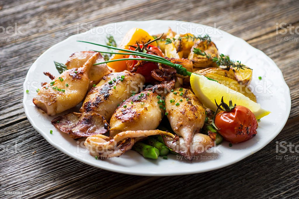 Grilled squids with asparagus and potato stock photo