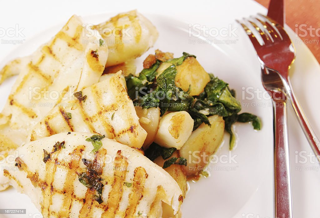 Grilled squids with potato royalty-free stock photo