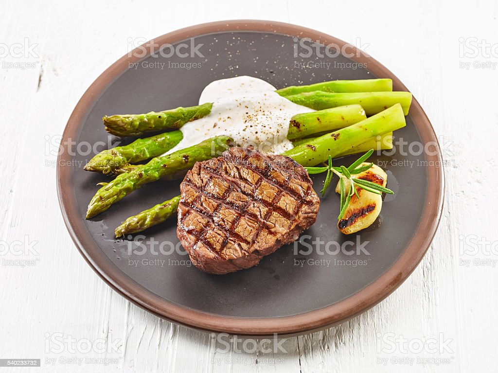 grilled steak and asparagus stock photo