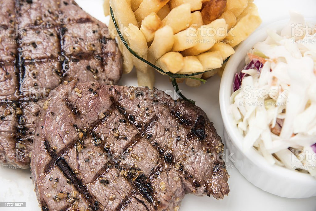 Grilled steak and french fries royalty-free stock photo