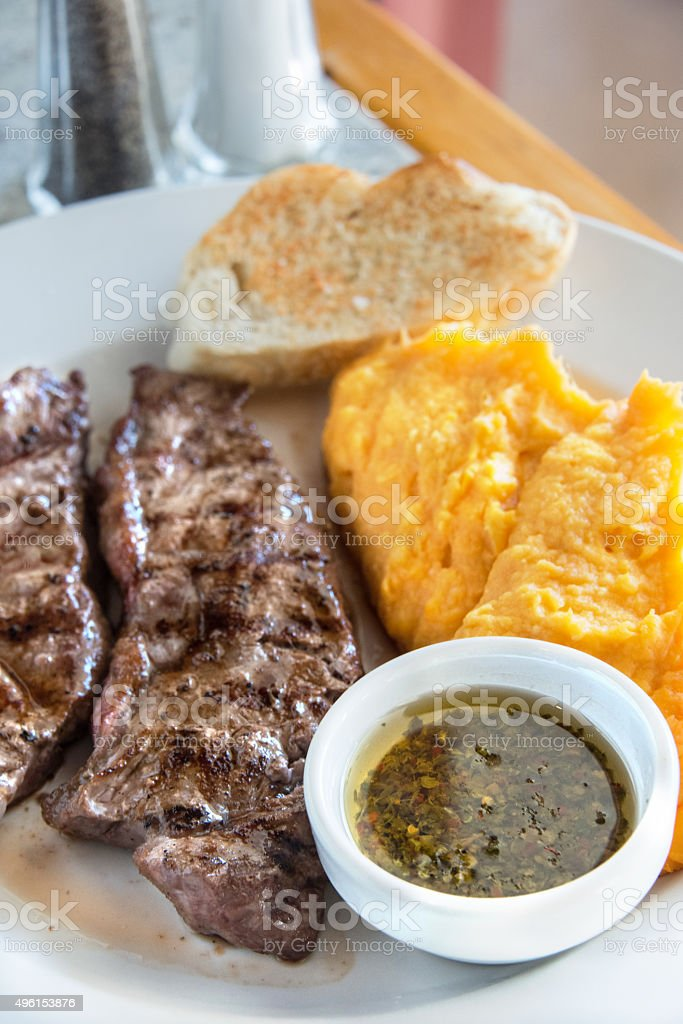 Grilled steak and mashed sweet potatoes stock photo