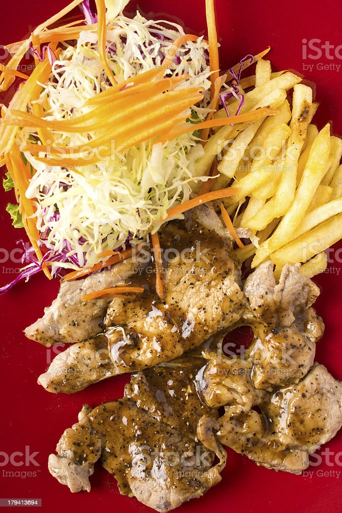 Grilled steak French fries and vegetables royalty-free stock photo