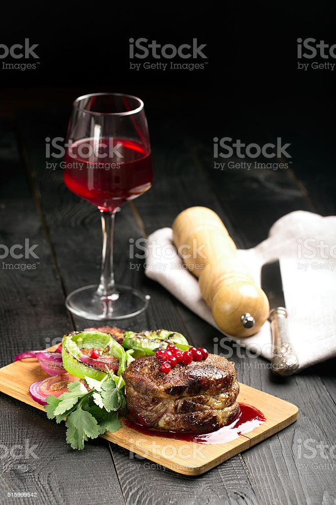 Grilled Steak Meat on the wooden surface stock photo