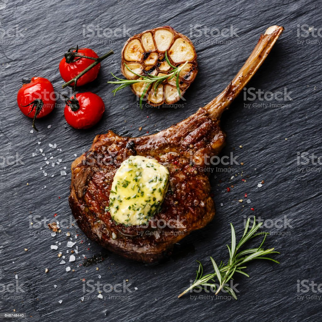 Grilled Steak on bone Veal rib with herb butter stock photo