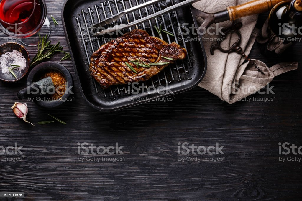 Grilled Steak on pan and red wine stock photo