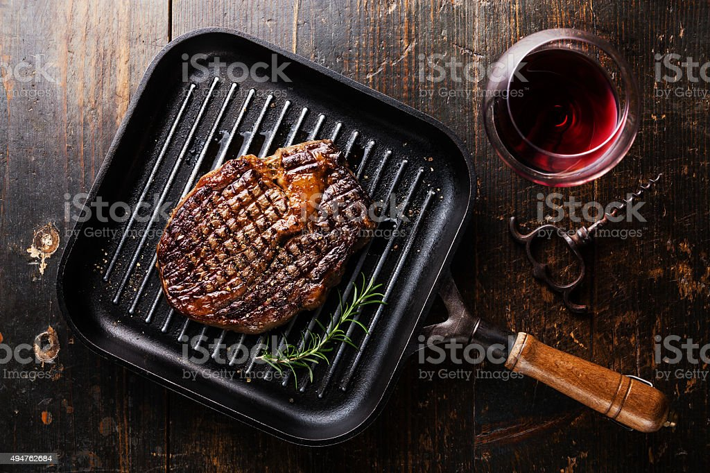 Grilled Steak Ribeye on pan and wine stock photo
