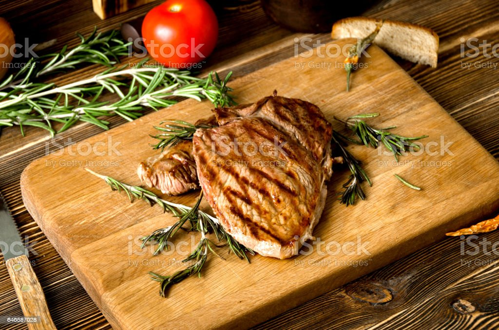 grilled steak rosemary rectangular wooden cutting board spices stock photo