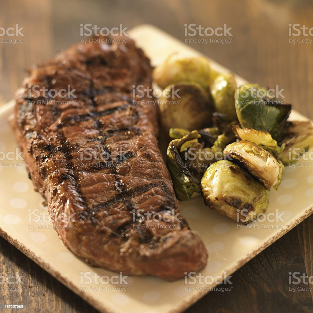 Grilled steak with Brussel sprouts on a plate stock photo