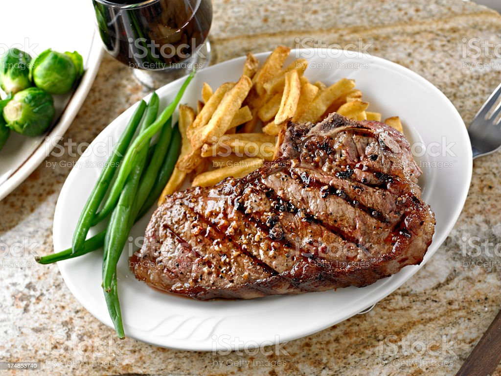 Grilled Steak with French Fries. stock photo