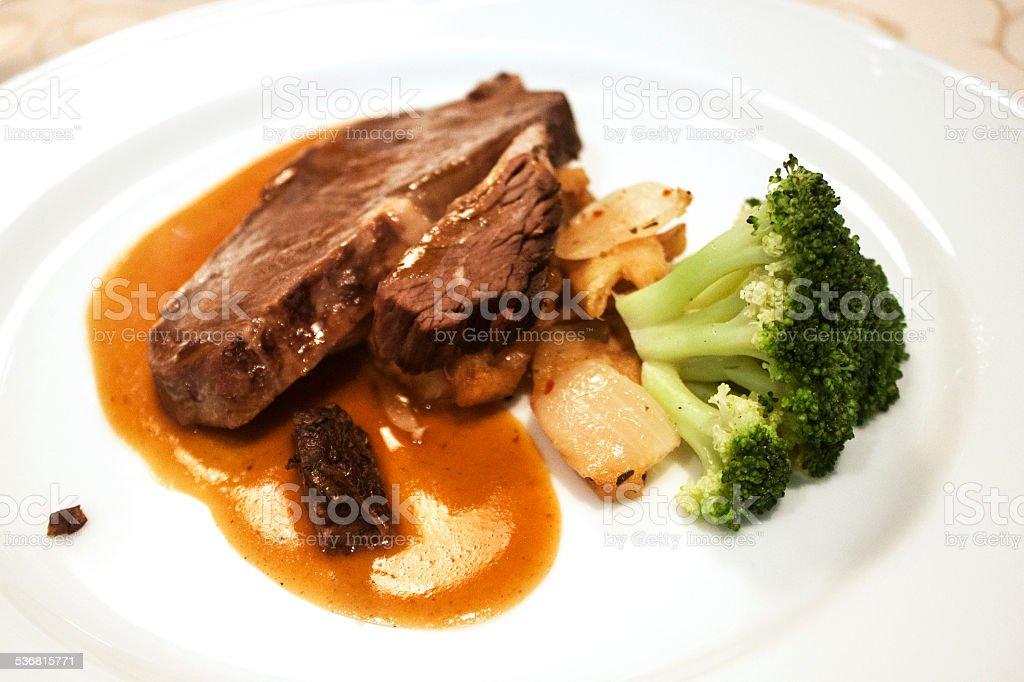 Grilled steak with garnish of cauliflower stock photo