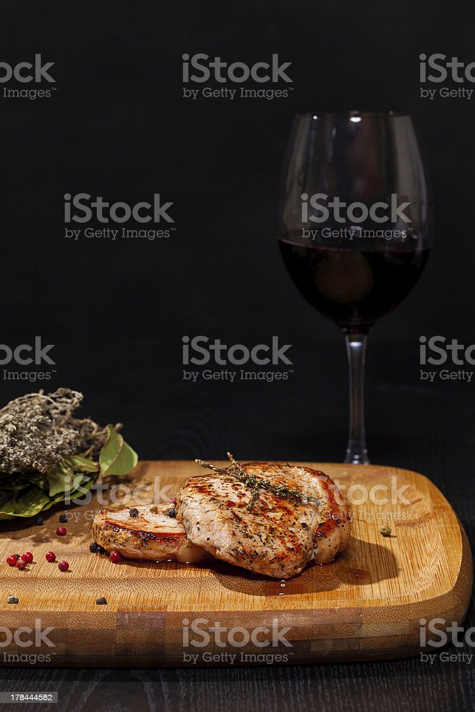 Grilled steak with glass red wine royalty-free stock photo