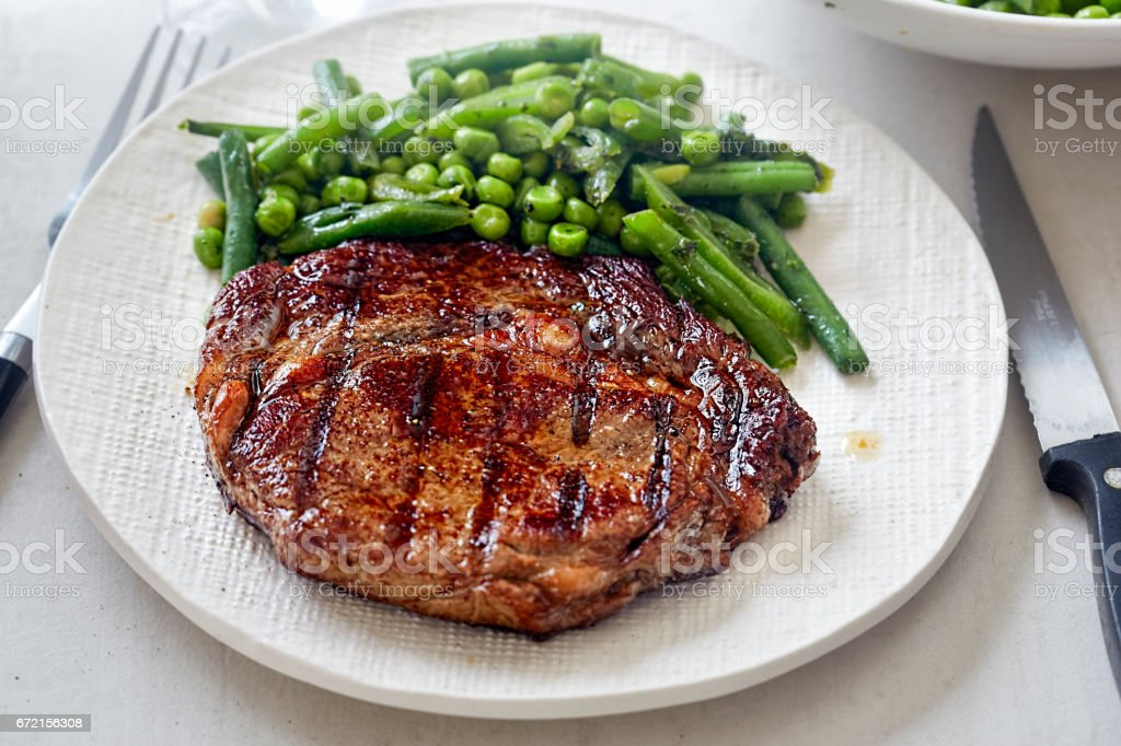 Grilled steak with green vegetables stock photo