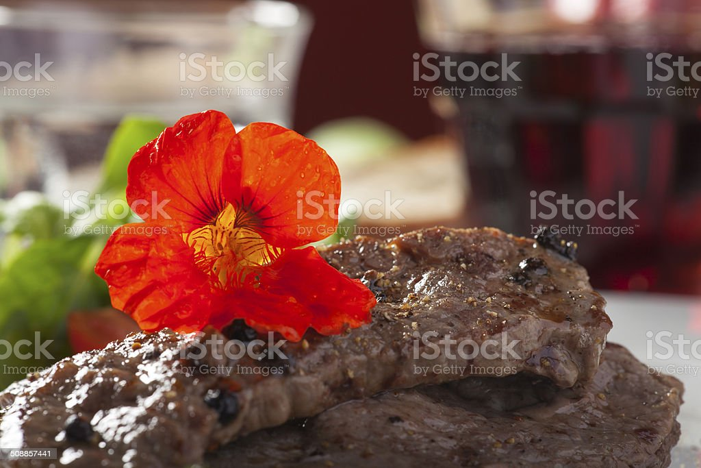 grilled steak with indian cress flower stock photo