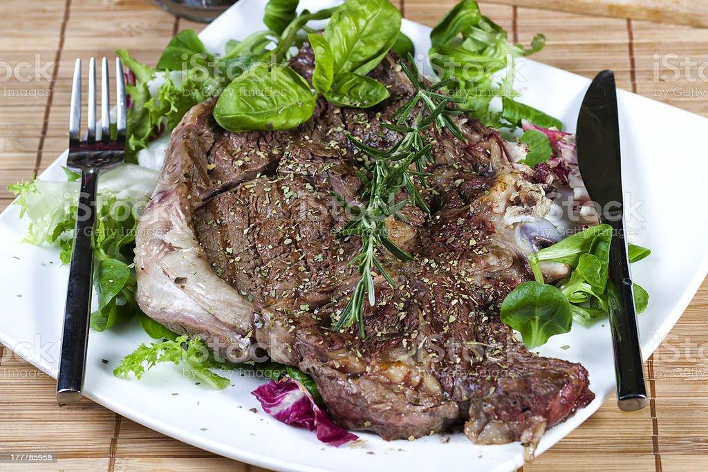 Grilled steak with mixed salad royalty-free stock photo