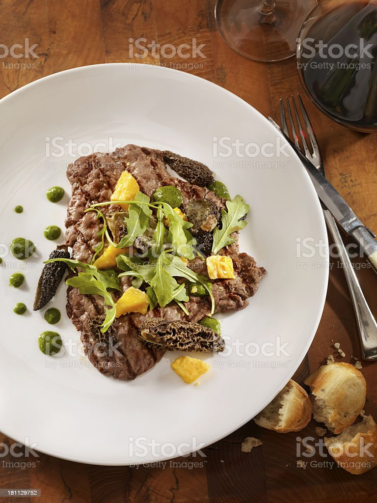 Grilled Steak with Mushrooms and Arugula royalty-free stock photo