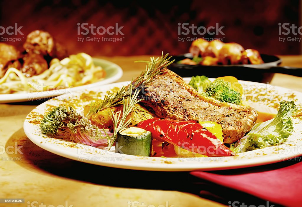 Grilled Steak with Rosemary and Roasted Vegetables royalty-free stock photo