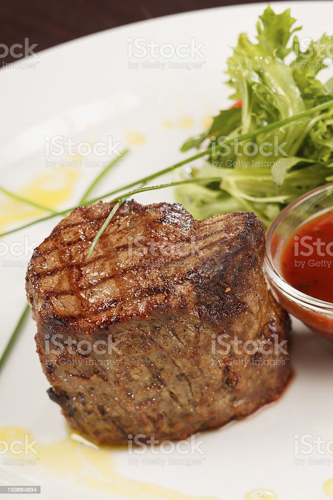 Grilled steak with sauce royalty-free stock photo