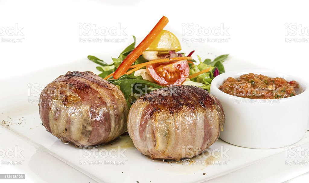 Grilled steak wrapped in bacon, with vegetables royalty-free stock photo