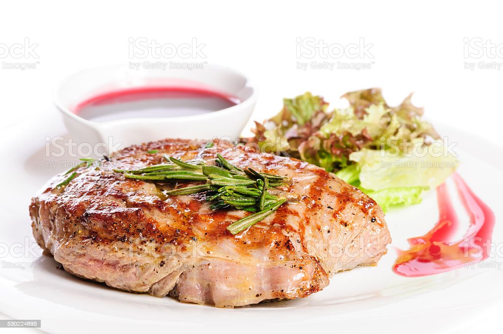 Grilled steaks and vegetable salad stock photo