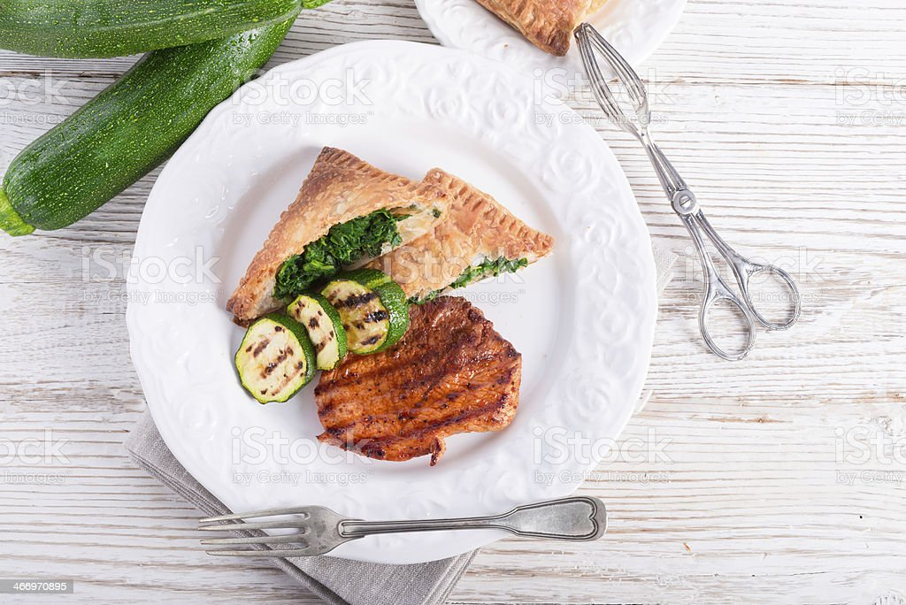 grilled steaks with puff pastry bag and zucchini royalty-free stock photo
