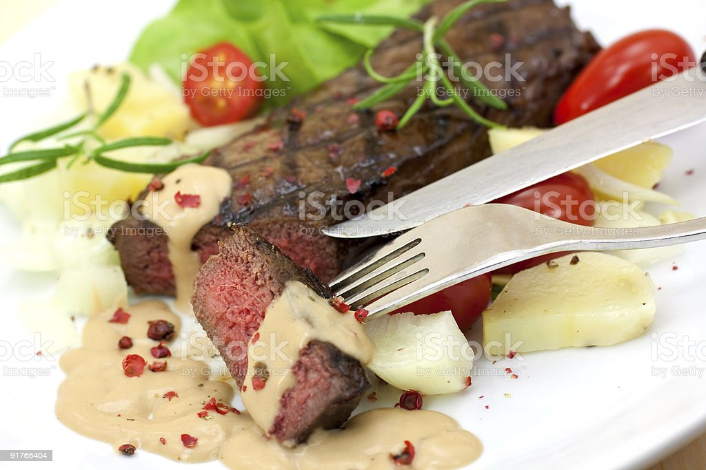 grilled strip steak with a chunk royalty-free stock photo