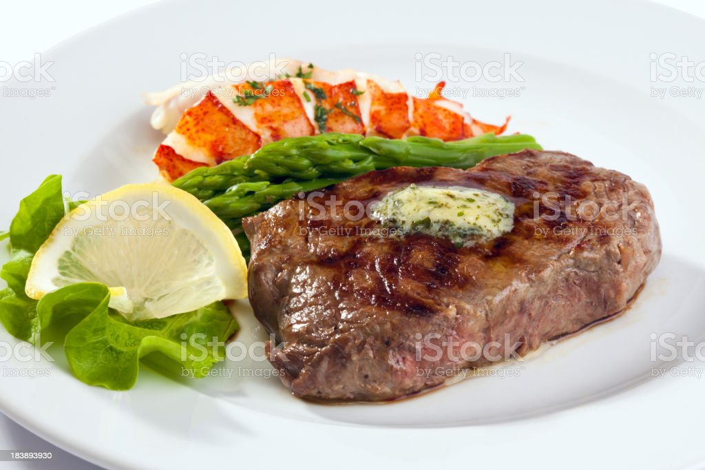 Grilled strip steak with lobster stock photo