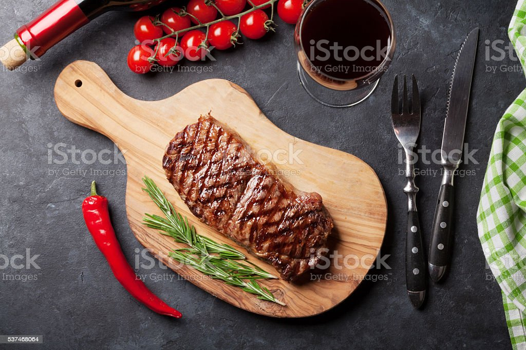 Grilled striploin steak and red wine stock photo